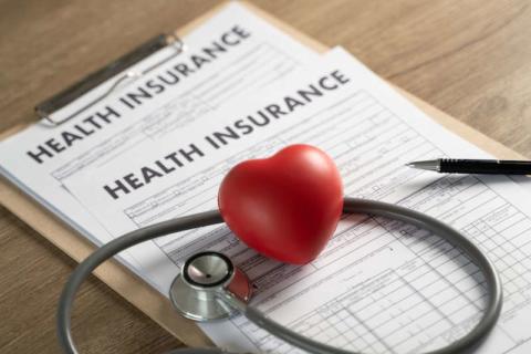 health-insurance-clipboard-stethoscope-heart